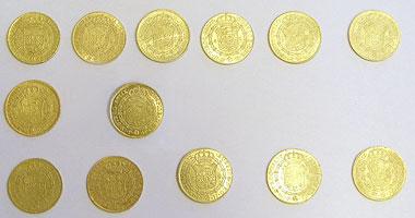 13 escudos de la época de Carlos III hallados en Córdoba (septiembre de 2009)